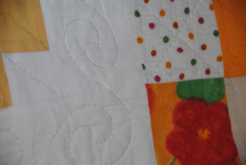 handgearbeiteter Blütenquilt